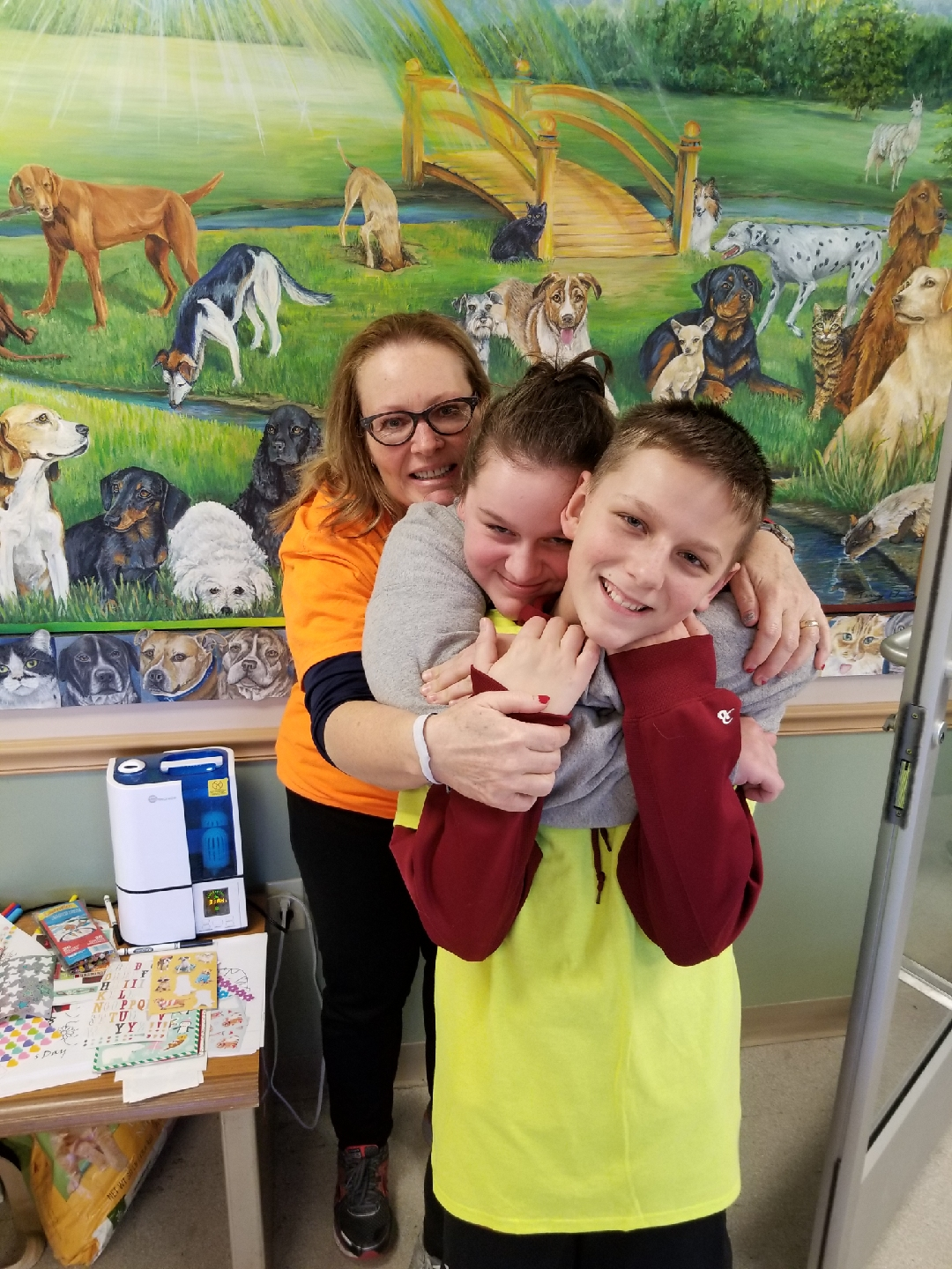 Sabine Fidler (orange shirt), HR Assistant, and her niece, Gabi, and nephew, Alex, having some fun during our ARL event.