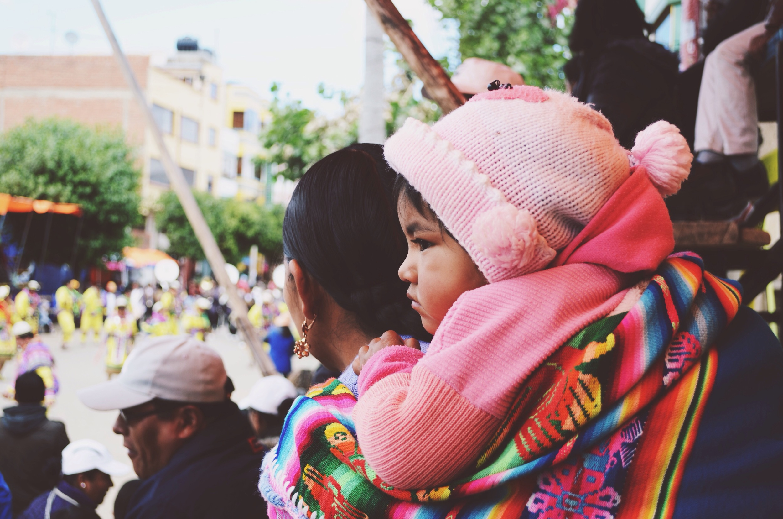 A young spectator bundled up in knits, and carefully bundled to her mother's back // 15 february 2015