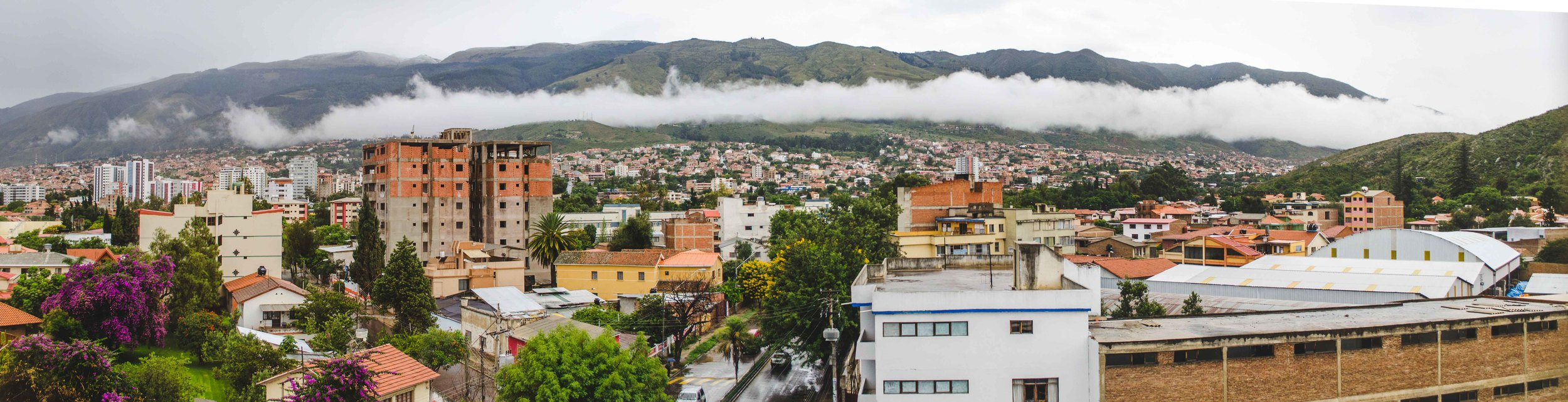 panorama of cochabamba after a rain - with a cloud settled into the hills