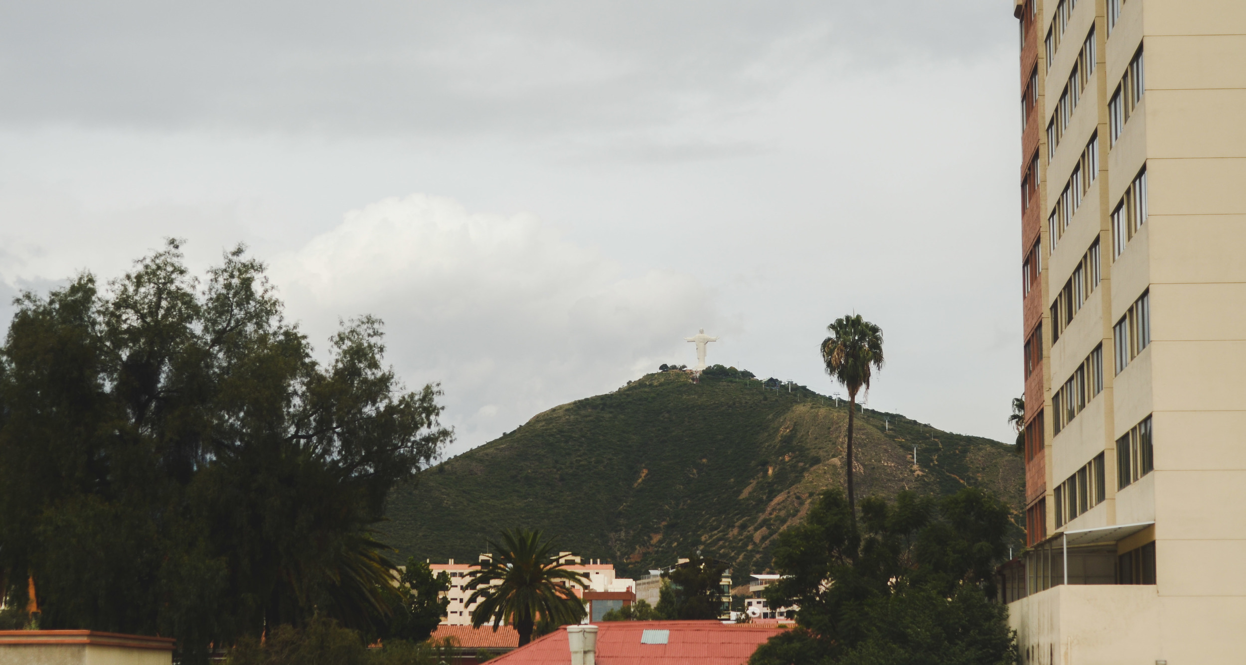 Cristo de la Concordia in the distance, a statue of Christ 40m tall on el  cerro de San Pedro