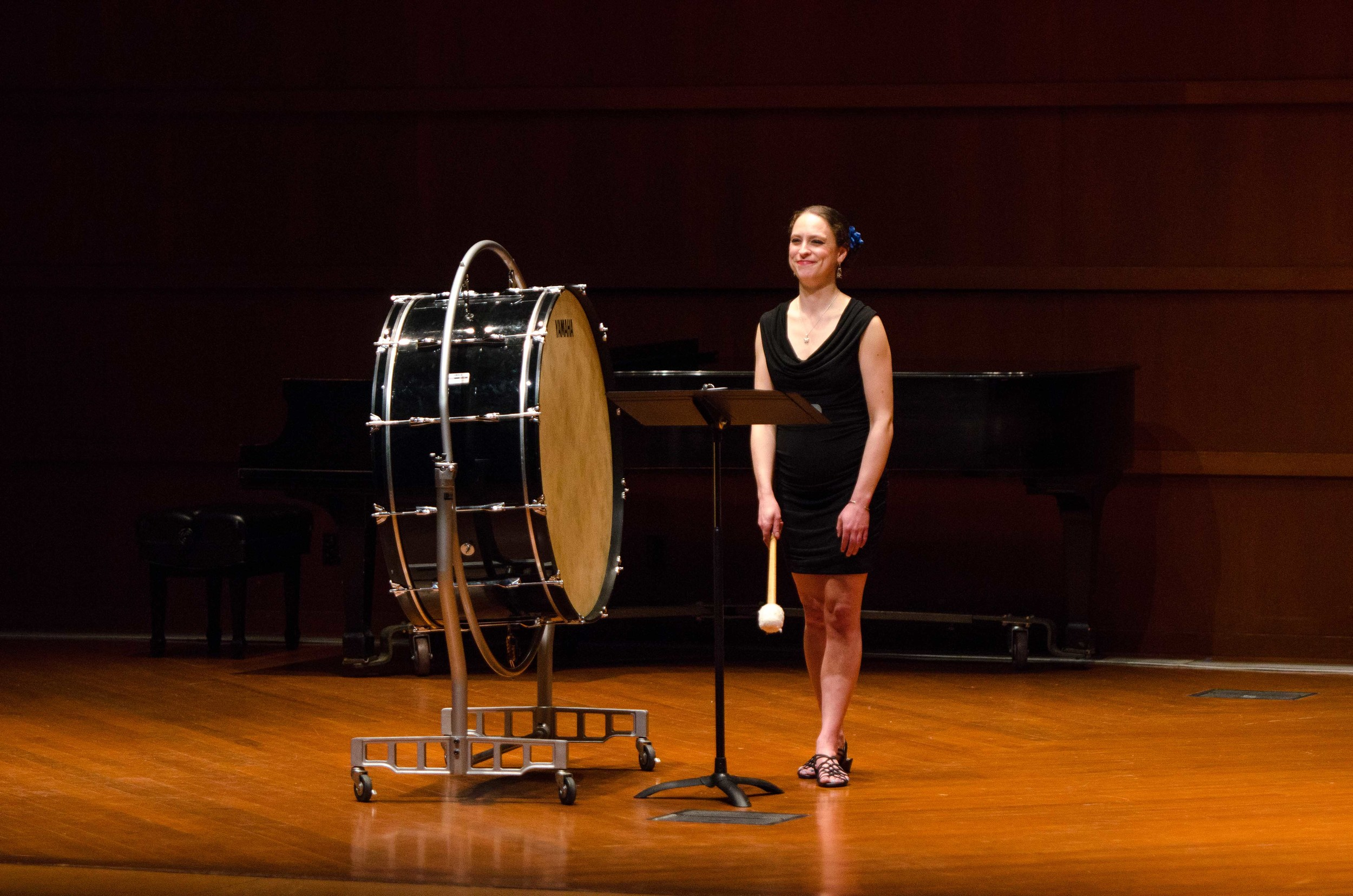 Mezzo-Soprano Lisa Neher performing a solo with bass drum.