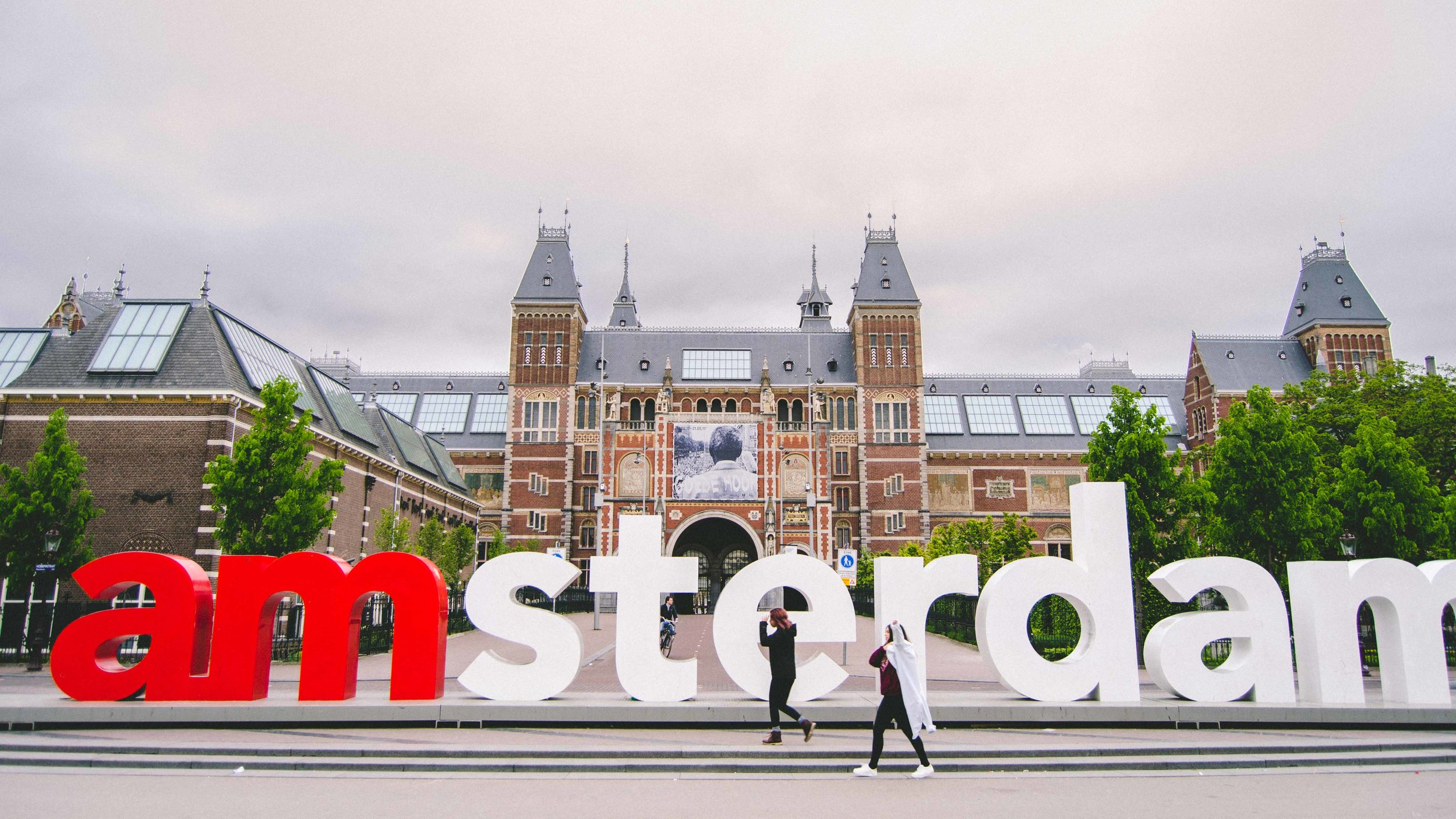 What the 'I Amsterdam' sign looks like at 6:45 in the morning. These two young women were from California and graciously took my photo before they left for the airport.