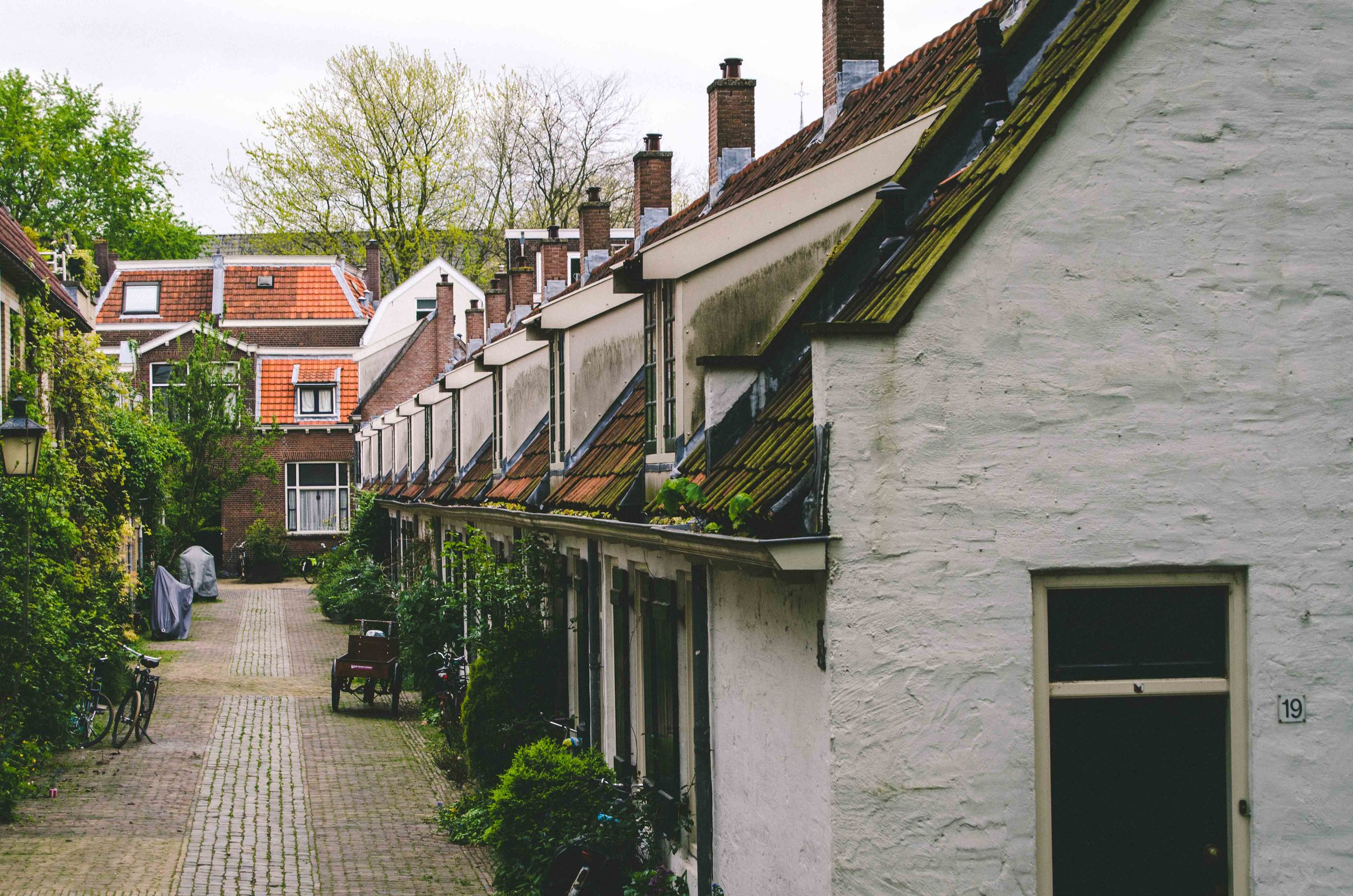 Near one of the canals is a lovely green space, bordered by residential housing with cobbled streets.
