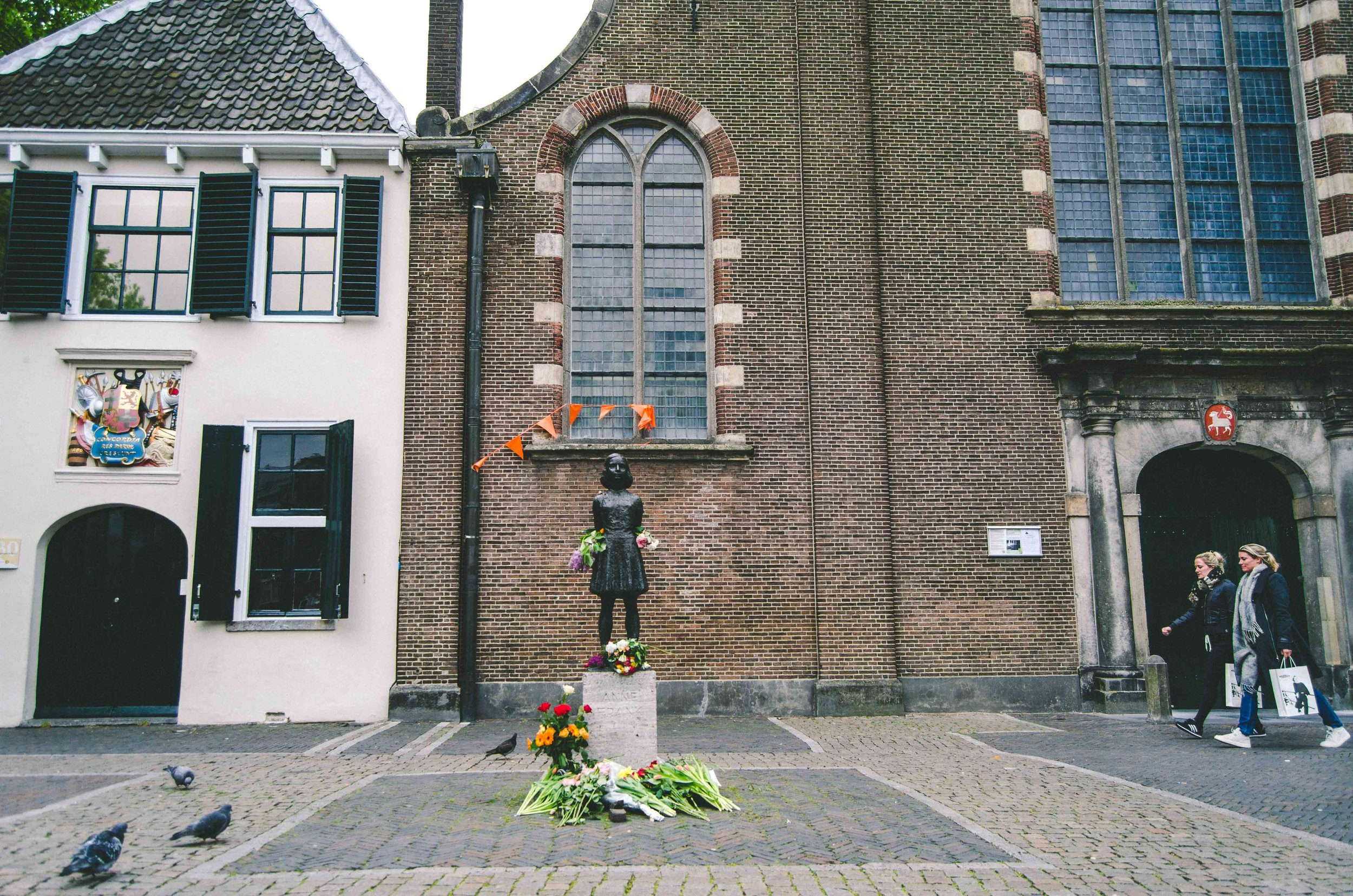Utrecht // Orange flags for Kings' Day, flowers by Anne Frank's statue for her birthday