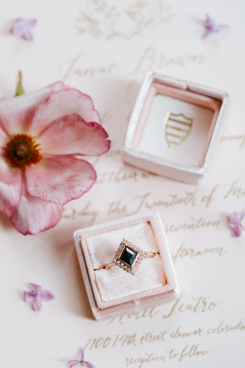 How to style wedding rings on invitations using flowers and a  Mrs. Box  by The Styled Soiree, photo by  Emily Sacco