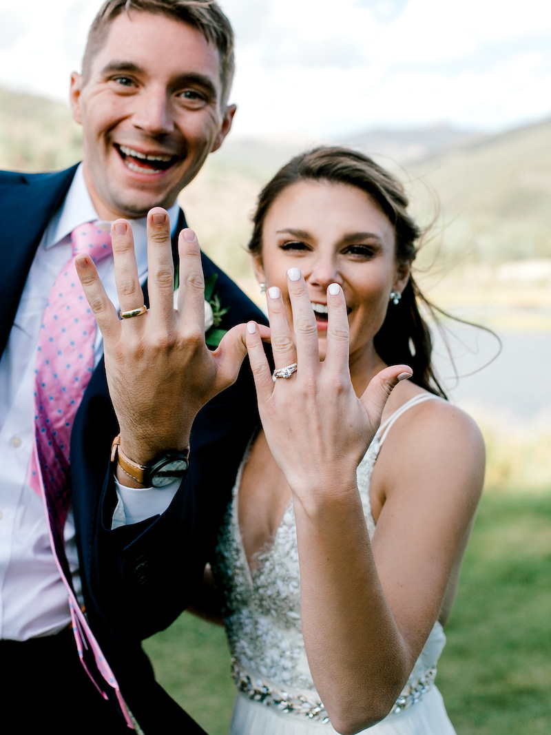 """Nothing says """"We Did!"""" like a fun ring photo and this one from a  Camp Hale  Wedding was perfect! You can see all the amazing images  here ! Captured by  Sara Lynn Photo  and planned by The Styled Soiree"""