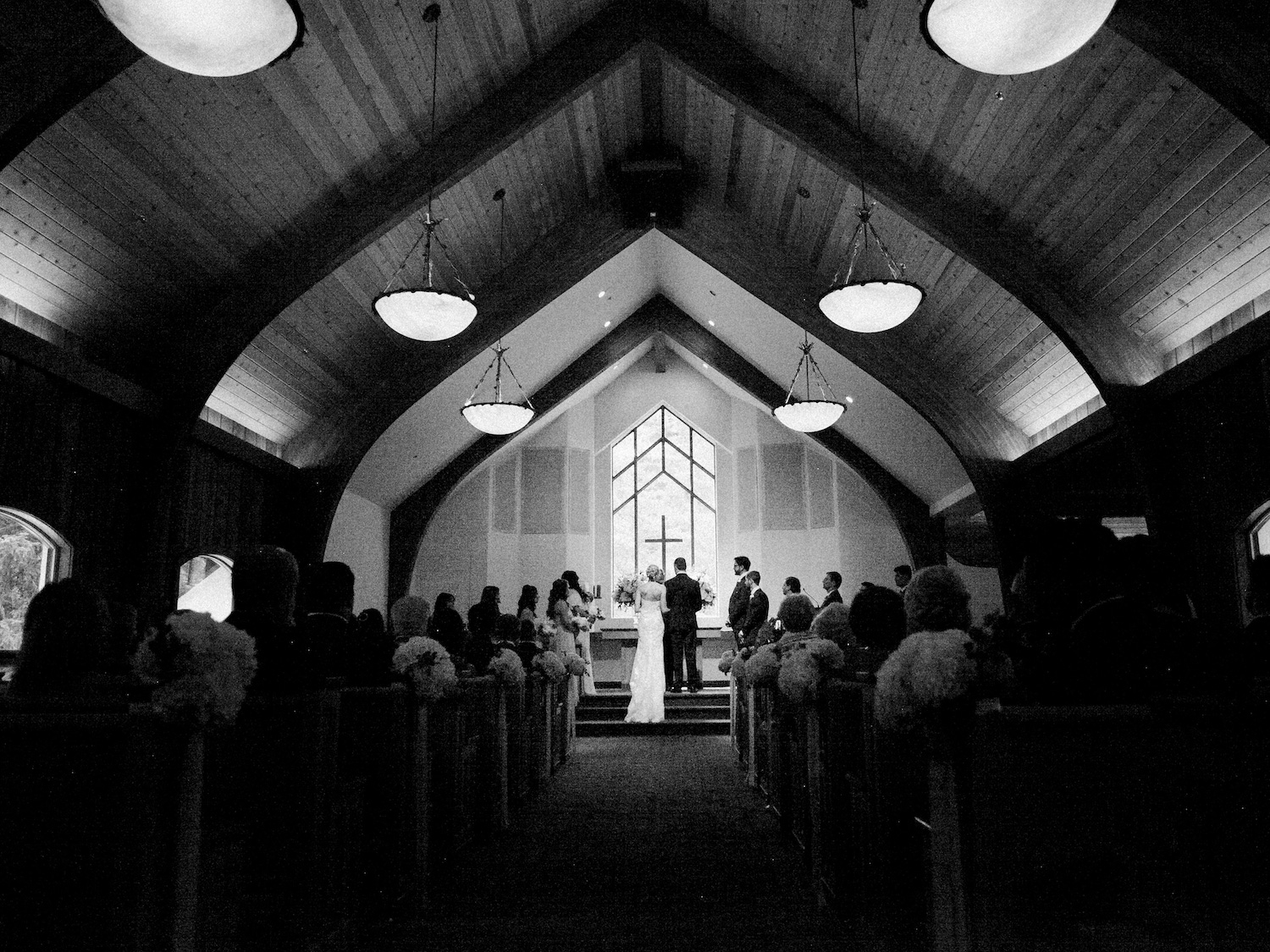 Wedding ceremony at Vail Interfaith Chapel in black and white