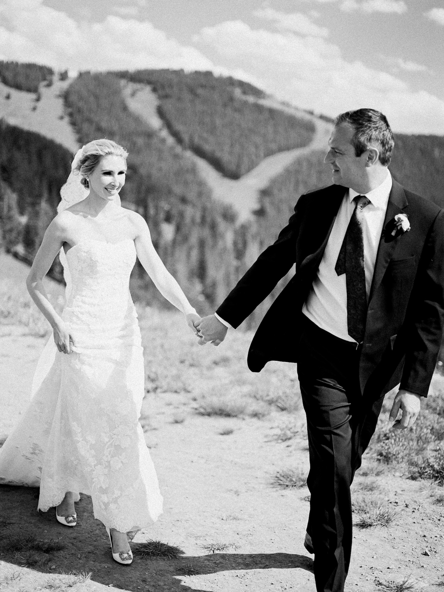 Bride and Groom walking on top of a mountain in Vail, Colorado