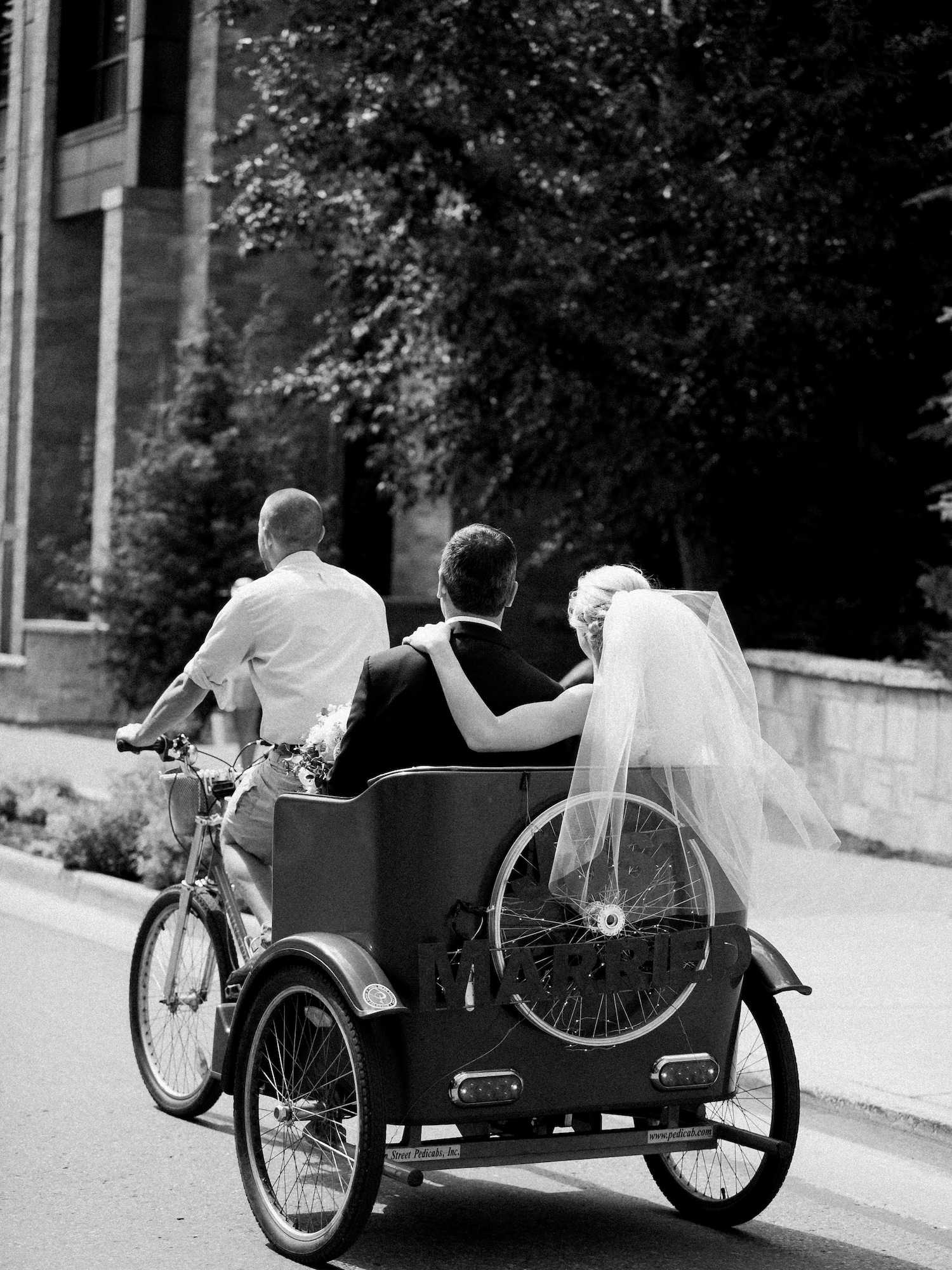 Newlywed couple using Vail Pedicab to go to the Gondola from Sonnenalp