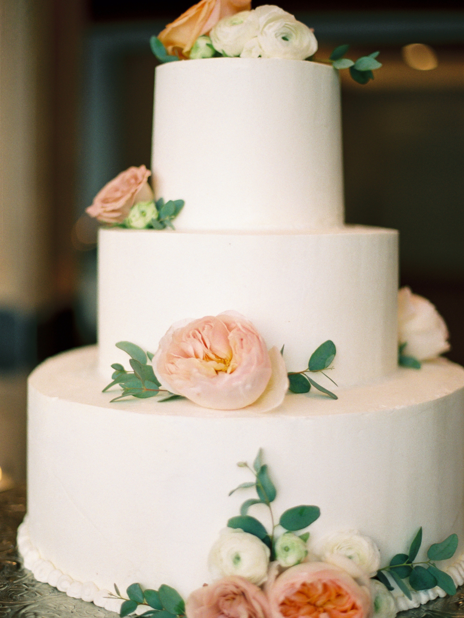 Classic white wedding cake with flowers from The Sonnenalp