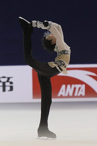 Yuzuru Hanya executing a Biellmann spin – named for Swiss skater Denise Biellmann, who popularized it – at the 2011 Cup of China. Photograph by David W. Carmichael.