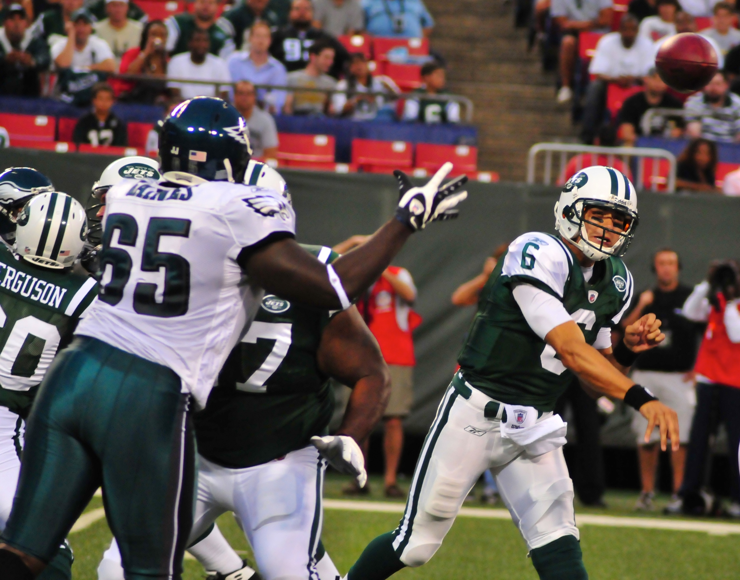 Mark Sanchez, former New York Jets' quarterback, throws a pass in 2009 against the Philadelphia Eagles, whose erstwhile QB, Michael Vick, is now with the Jets.  Ah, the ironies. Photograph by Ed Yourdon.