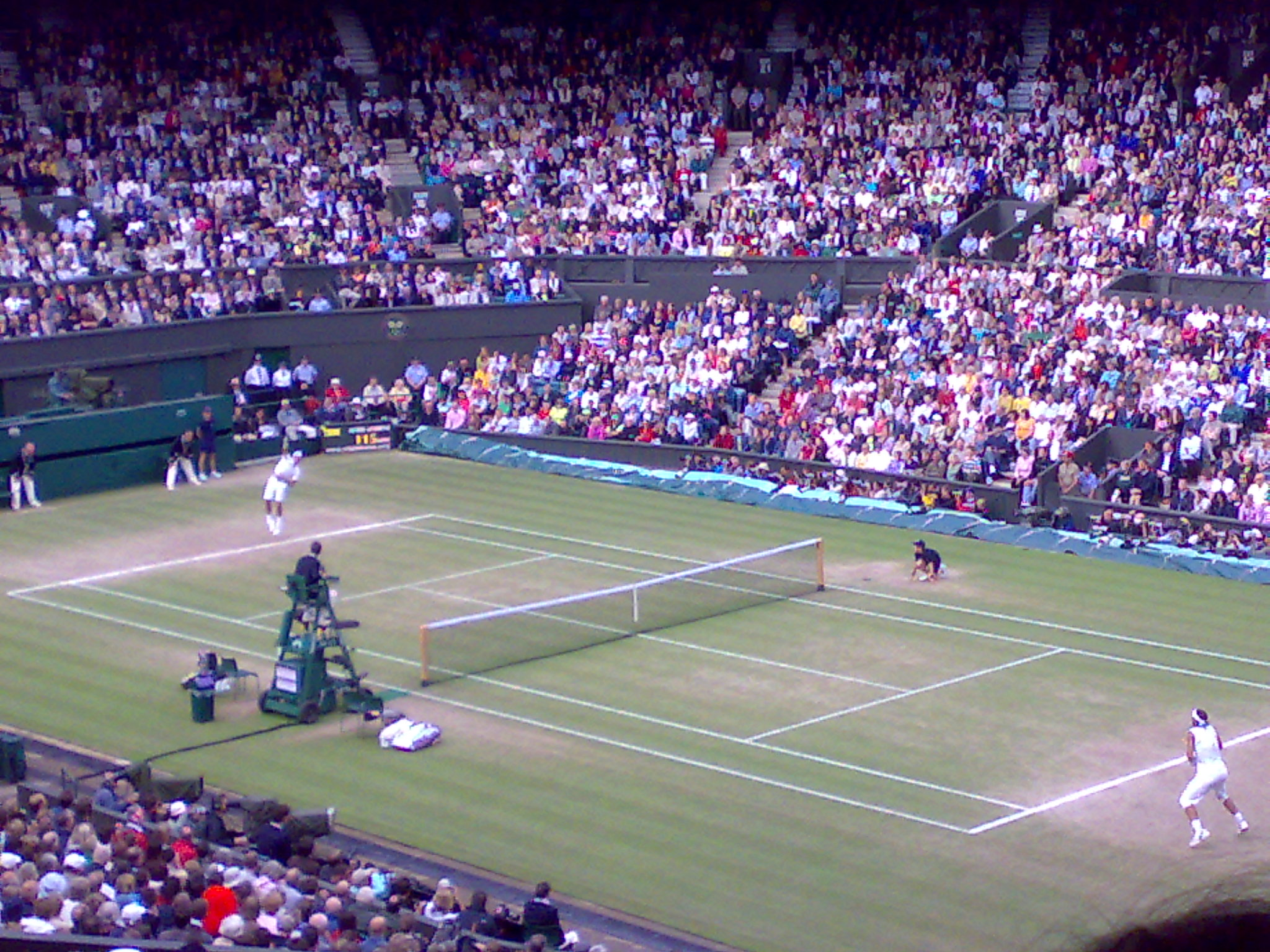 Roger Federer (far court) serves to Rafael Nadal during the 2008 Wimbledon final that some consider the greatest match ever.