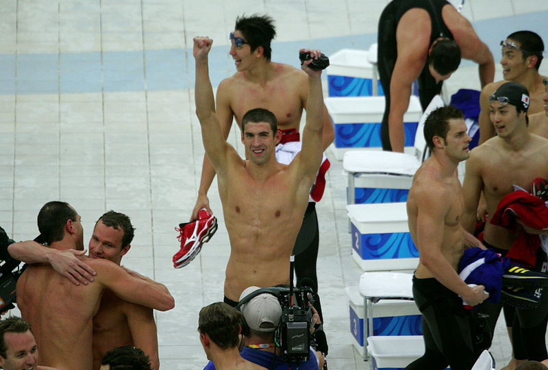 Michael Phelps celebrates his eighth gold medal of the Beijing Games with his teammates. Photograph by Bryan Allison.