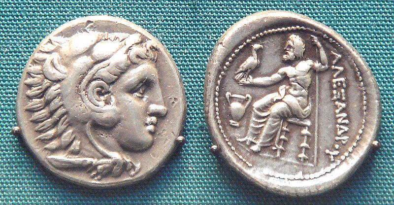A coin of Alexander the Great wearing the lion's head cap of his great ancestor, Herakles (Hercules), British Museum.