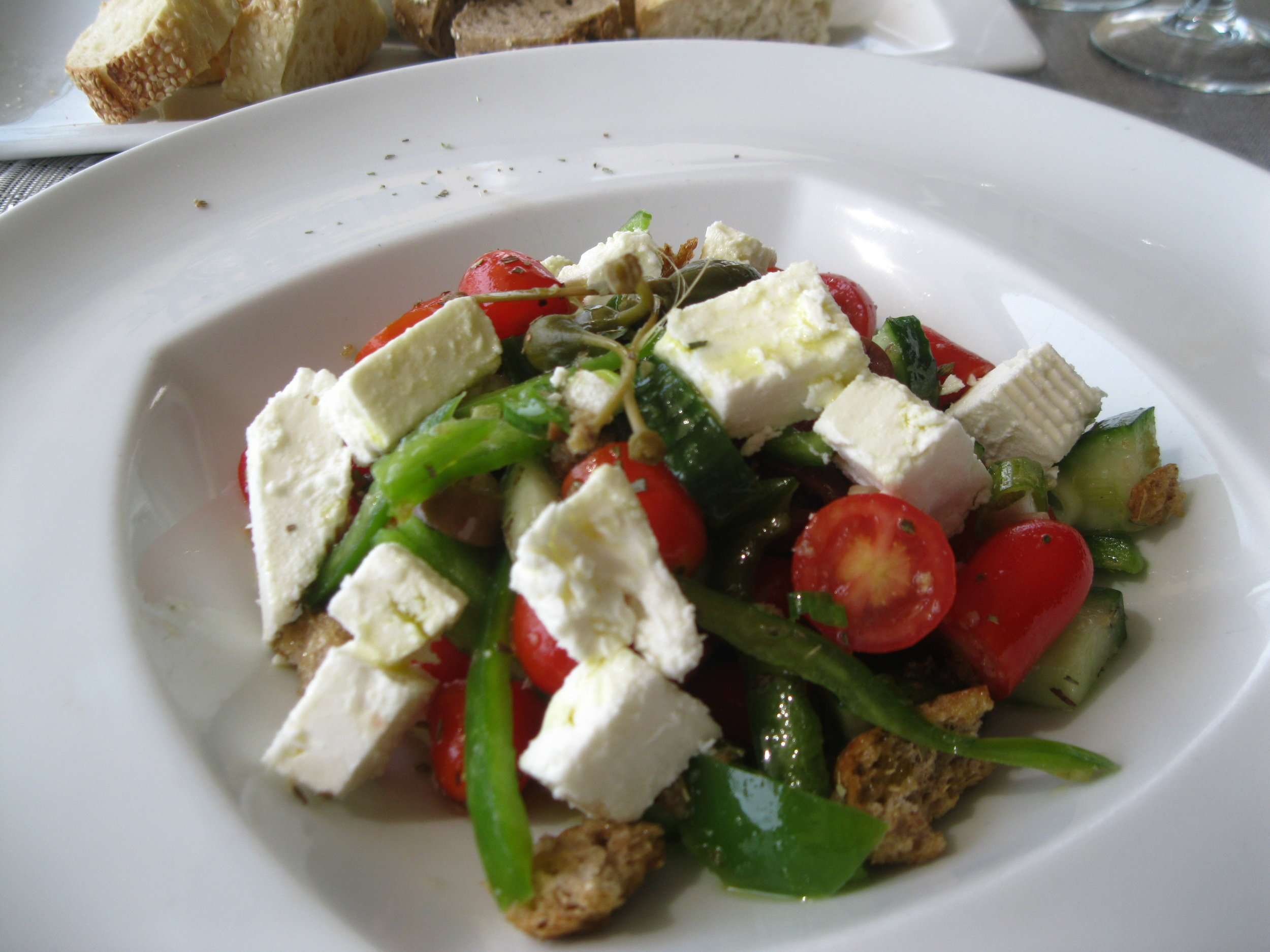 A staple of the Greek diet – a salad of feta and tomatoes, this one prepared at the St. George Lycabettus Boutique Hotel in Athens. Photograph by Georgette Gouveia.