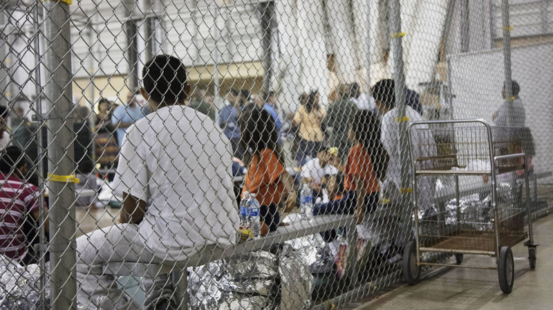 A photo provided by U.S. Customs and Border Protection shows people detained at a facility in McAllen, Texas, on Sunday. Image  here .