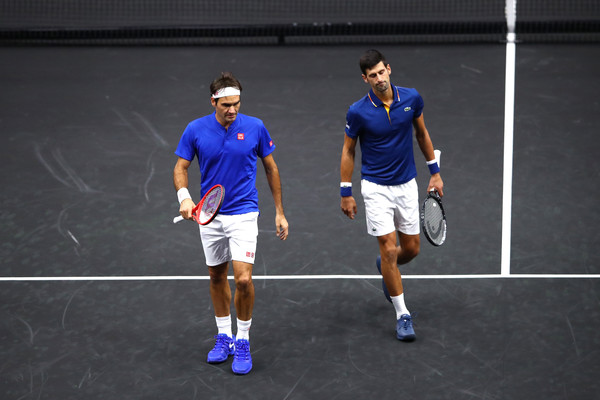 The Blues Brothers: Roger Federer and Novak Djokovic  bow  as a doubles team at the Laver Cup. Photograph by Clive Brunskill for Getty Images North America