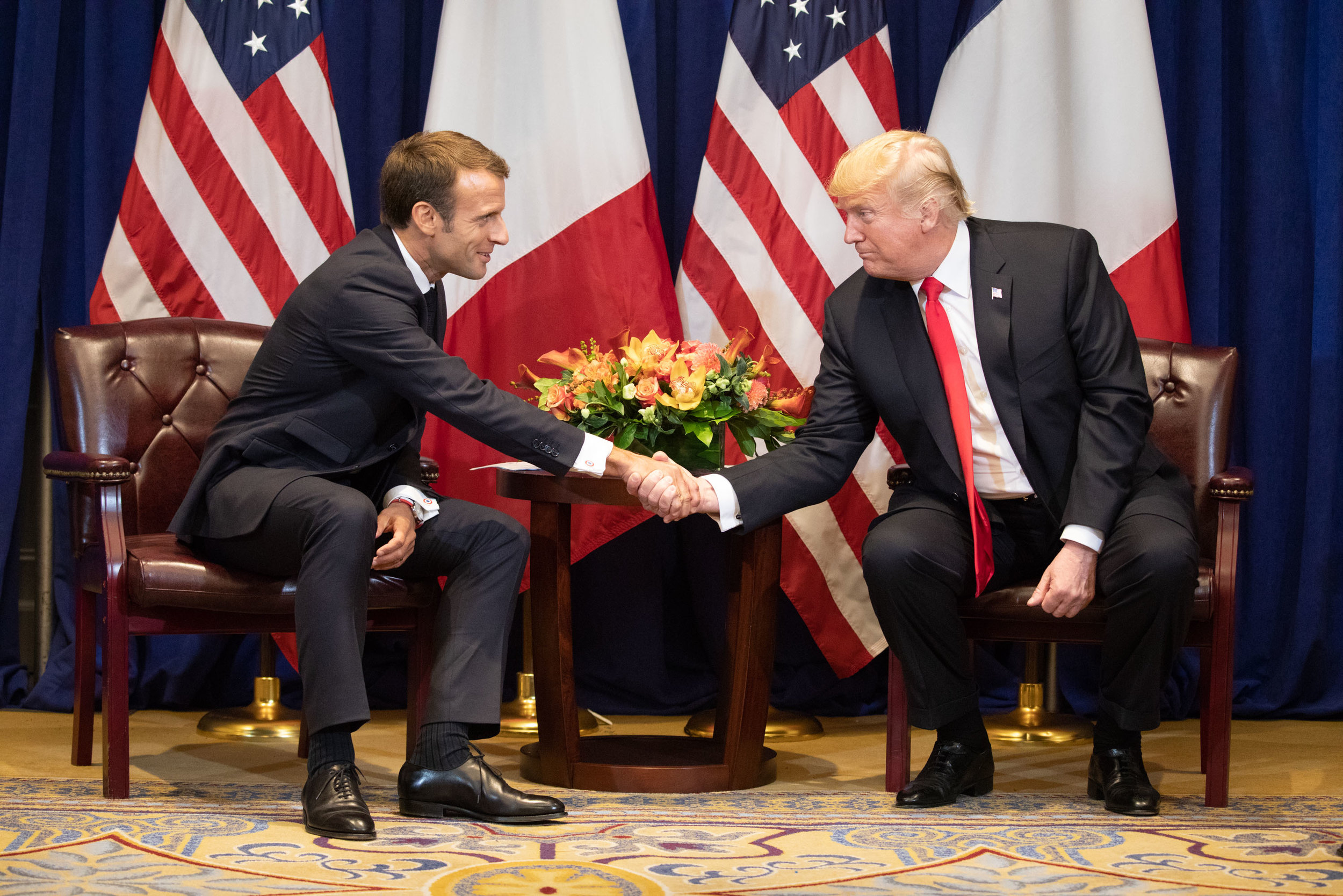 French President Emmanuel Macron and American President Donald J. Trump in happier times only months ago at the United Nations General Assembly. Pundits say the bromance is over, but what looked like a bromance was really just Macron taking one for the Euro team. Photograph by Shealah Craighead for the White House.
