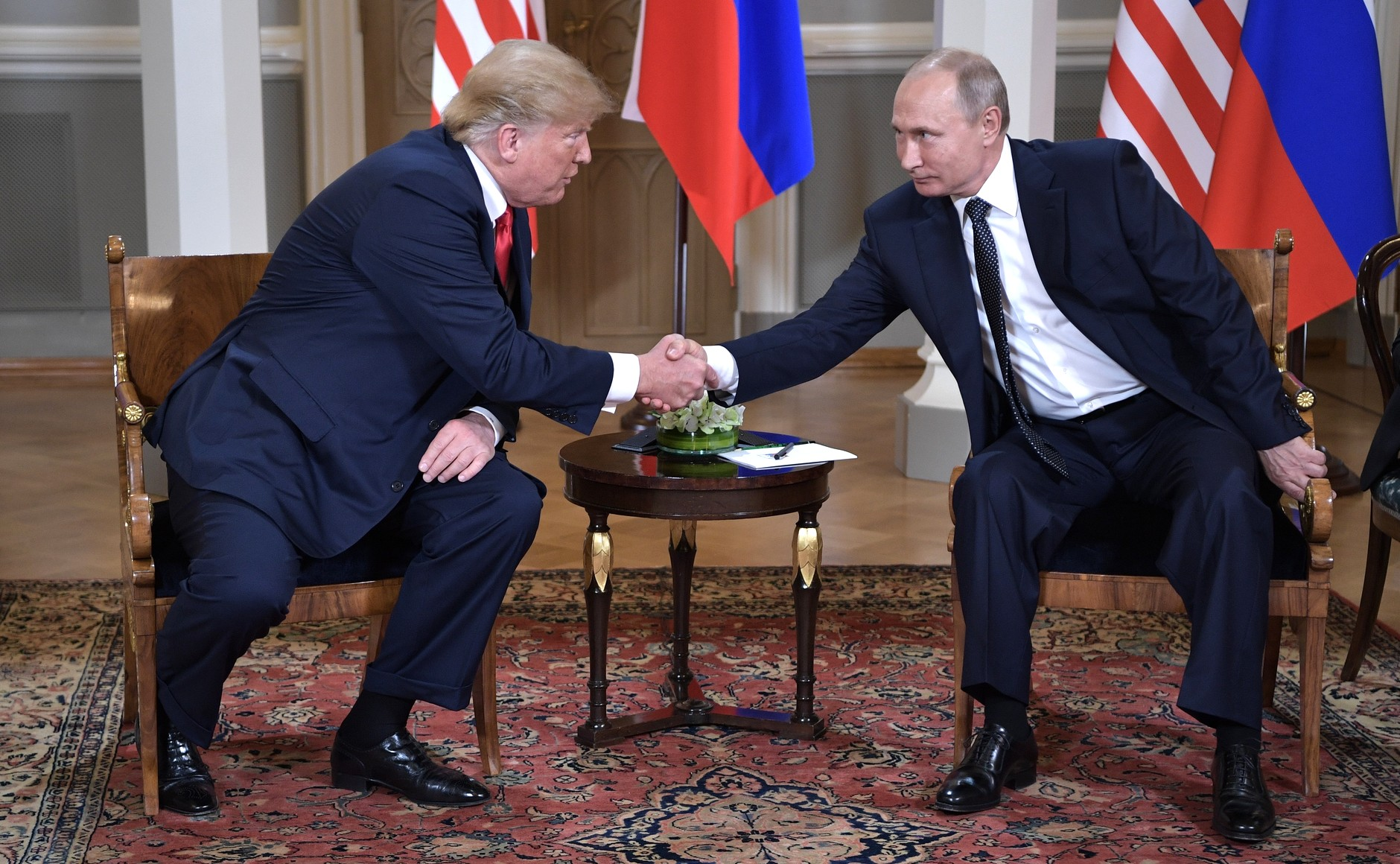 """""""The things we did last summer,  I'll remember all winter long"""": President Donald J. Trump and President Vladimir Putin meet in July in Helsinki. Photograph courtesy the Kremlin."""