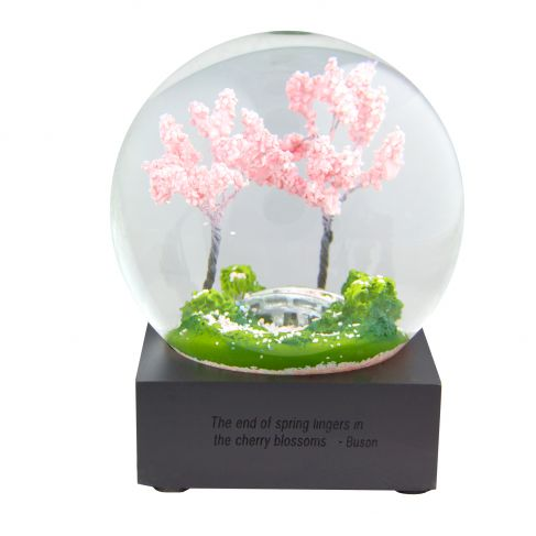 """The National Gallery of Art's cherry blossom snow globe, which I purchased just days before the government shutdown fully kicked in. It's inscribed with the words """"The end of spring lingers in the cherry blossoms."""""""