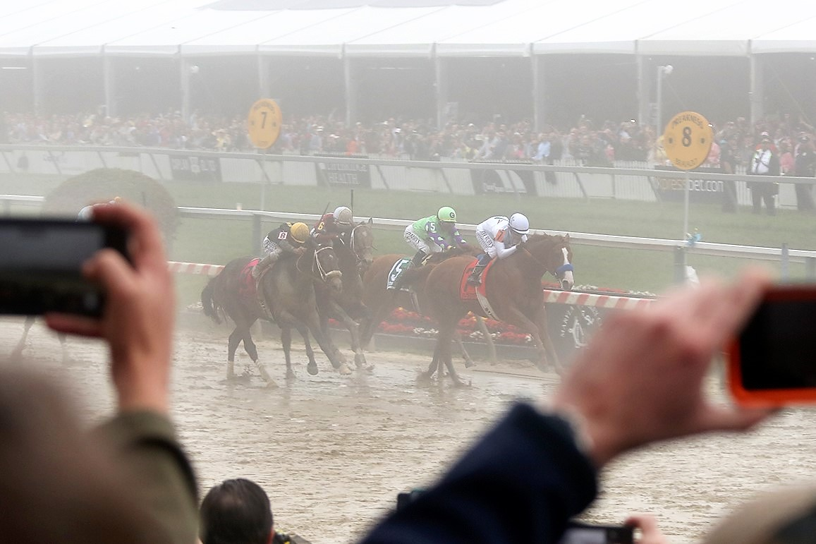 Fans capture the moment when Justify captures the Preakness Stakes in the slop last year on his way to the Triple Crown. Courtesy Maryland Governor's Office.