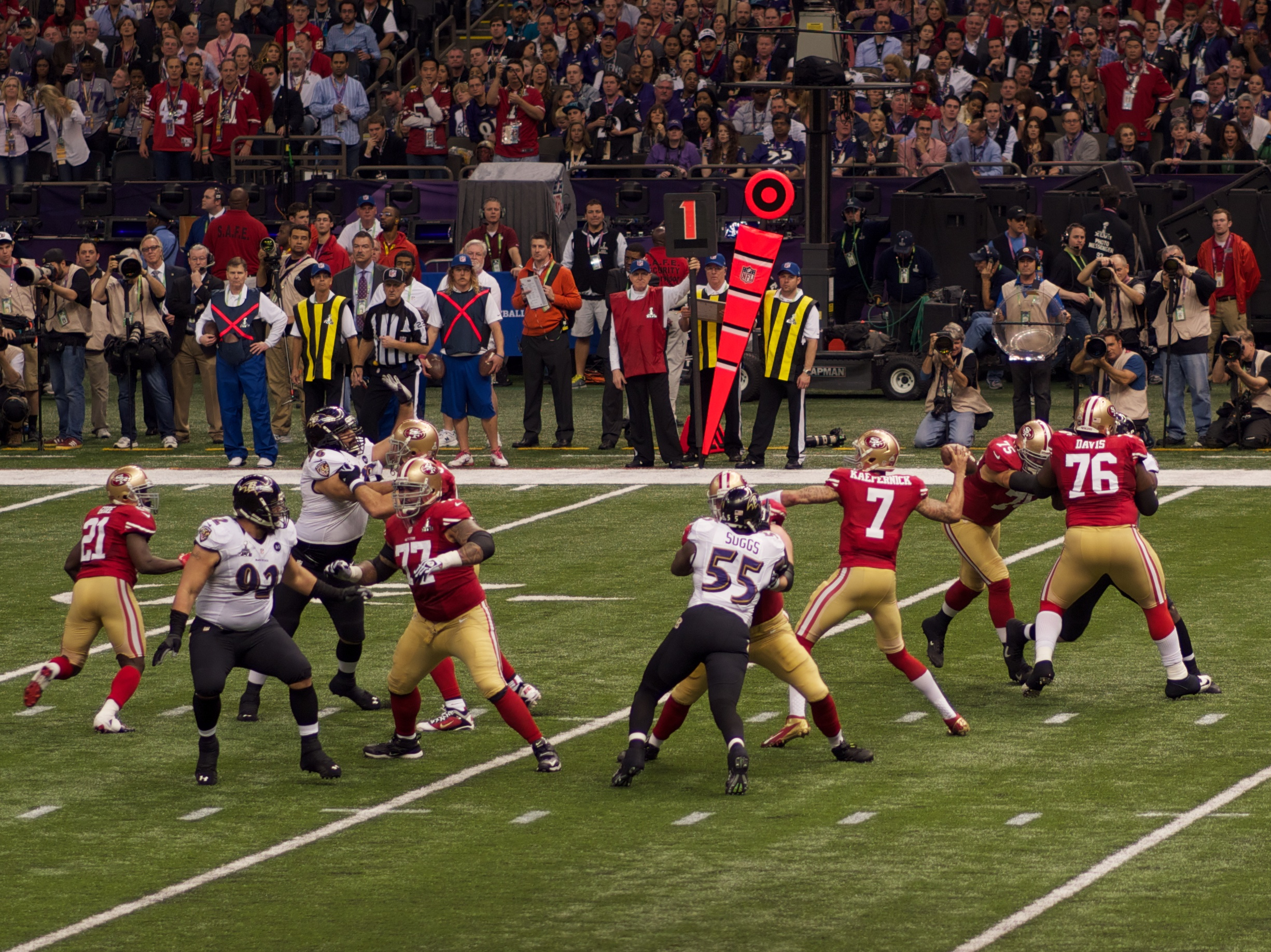 Colin Kaepernick (number 7) is set to throw a pass in Super Bowl XLVIII on Feb. 3, 2013.