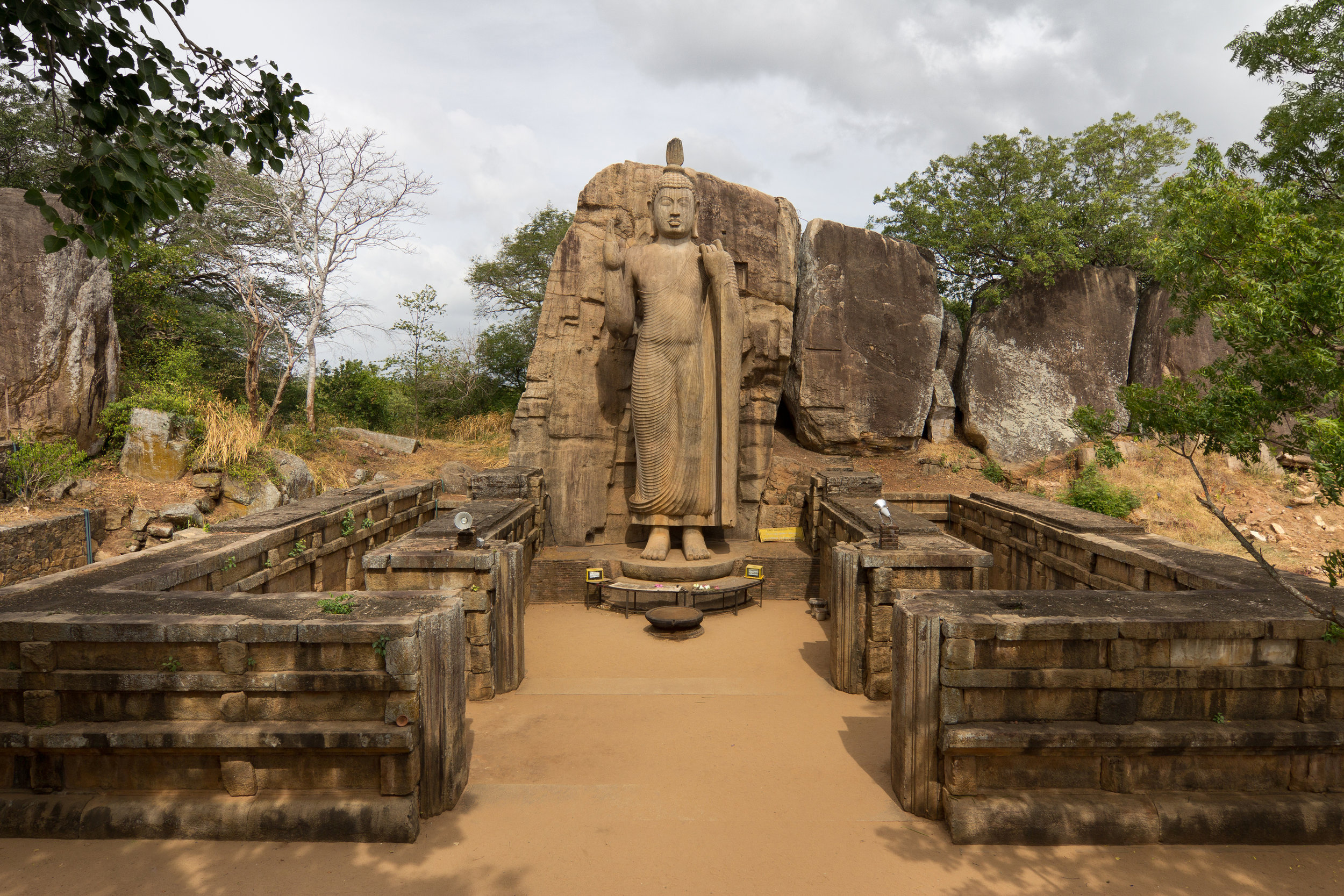 The Avukana Buddha, a fifth century Sri Lankan work. The island nation's serene beauty belies years of violence. Photograph by Carlos Delgado.