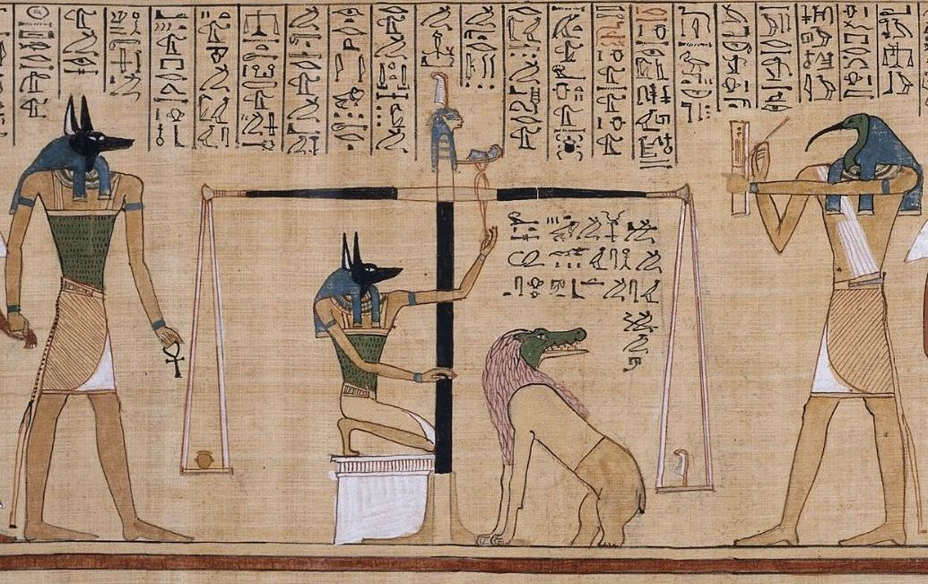 "A scene from ""The Ancient Egyptian Book of the Dead"" (British Museum), in which the heart of the deceased is measured against the feather of truth."