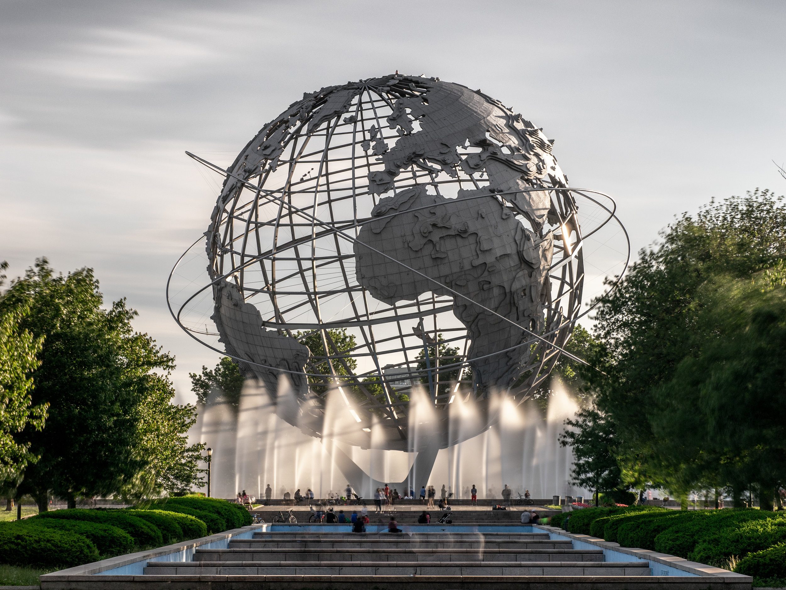 The Unisphere — symbol of the most global place on the face of the Earth, the polyglot New York City borough of Queens. It's the birthplace of President Donald J. Trump and part of it is in Representative Alexandria Ocasio-Cortez's district.