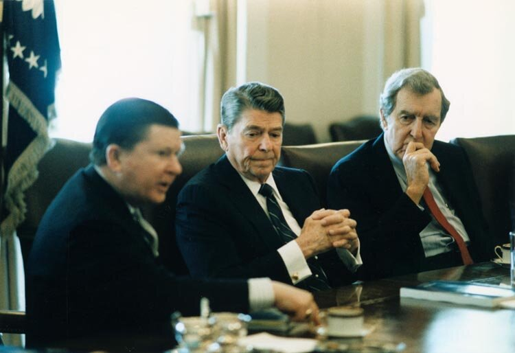 Ah, the good old days, when there was at least bipartisan cooperation in investigating intrigue:: President Ronald Reagan receives the Tower Commission Report on his administration's Iran-Contra scandal from two of the commission's members — Republican Sen. John Tower (left) and Democratic Sen. Edmund Muskie (far right). Courtesy the Ronald Reagan Presidential Foundation & Institute.