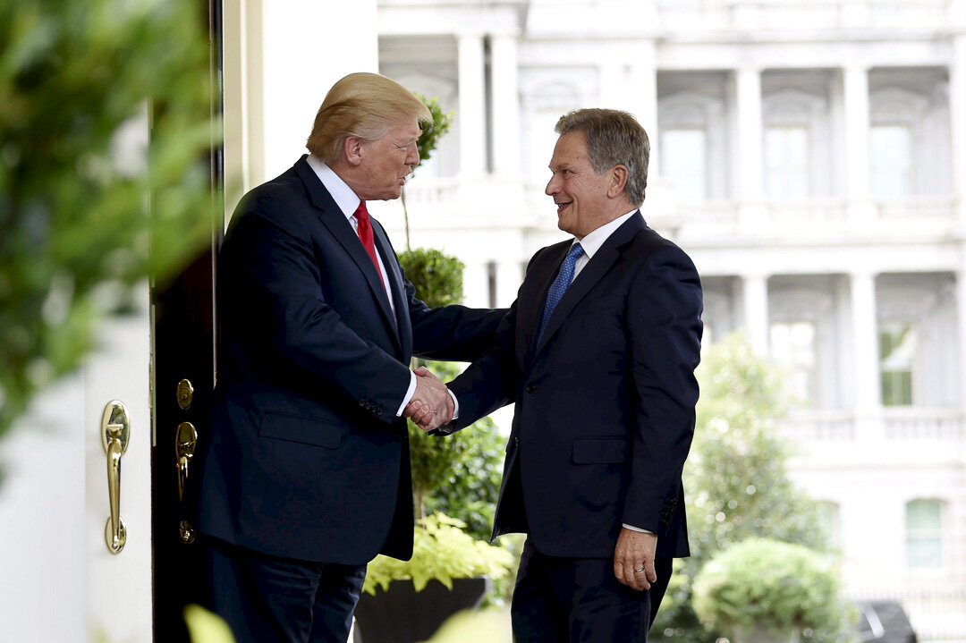 Stuck in the middle with you: President Donald J. Trump greets Finnish President Sauli Nanistö in happier times, Aug. 28, 2017. Photograph by Natig Sharifov.