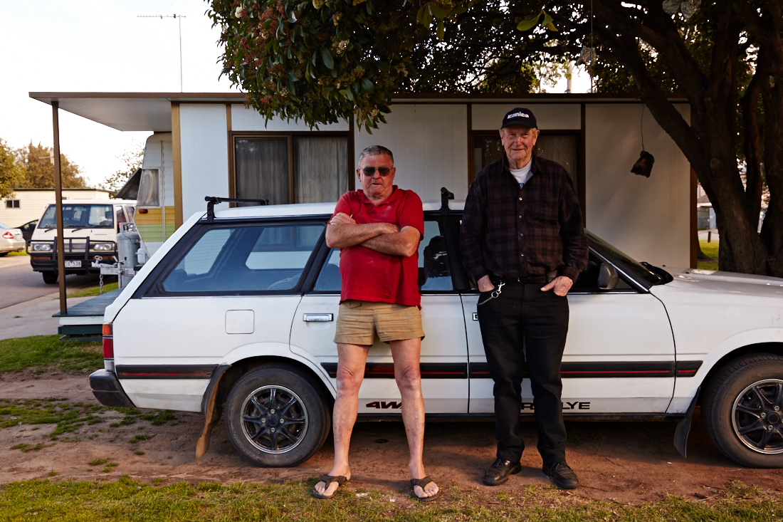 Ray Collinson and Lance Pilgrim stand in front of the former's caravan and annexe at Strayleaves, near Shepparton.