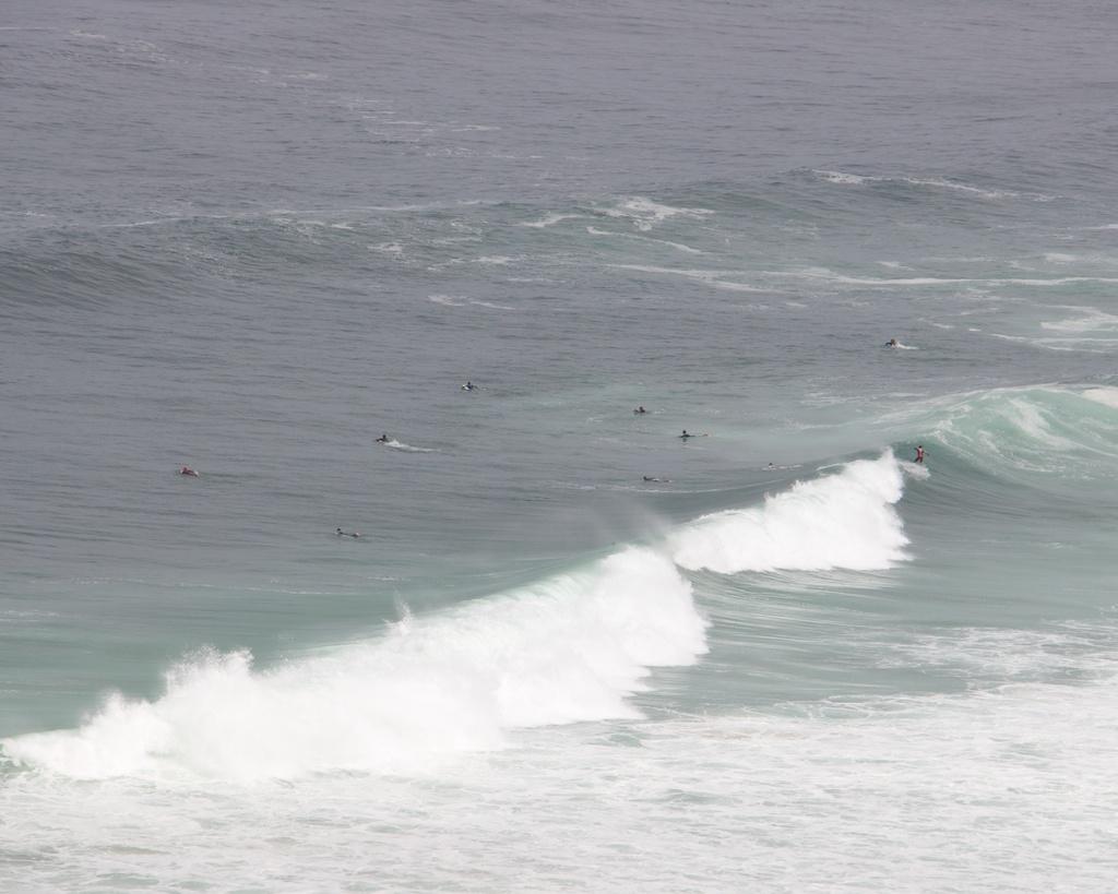 Surfers Around Praia Grande Portugal