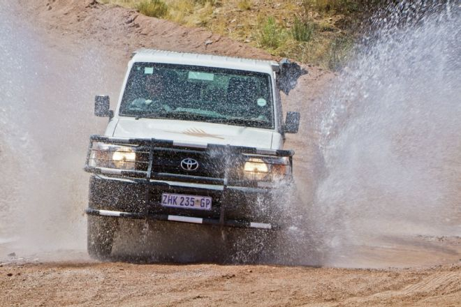Toyota Land Cruiser from KEA Rentals, equipped with an African Outback Products camper shell with an integrated rooftop tent, an Engel freezer/fridge, and more.