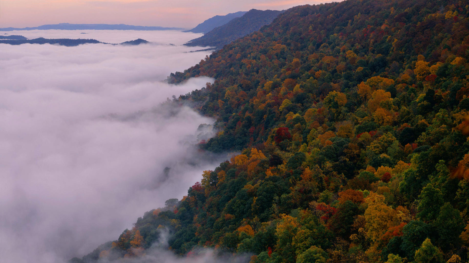 Fog lifting from Breaks Canyon  (photo courtesy  outpostUSA )