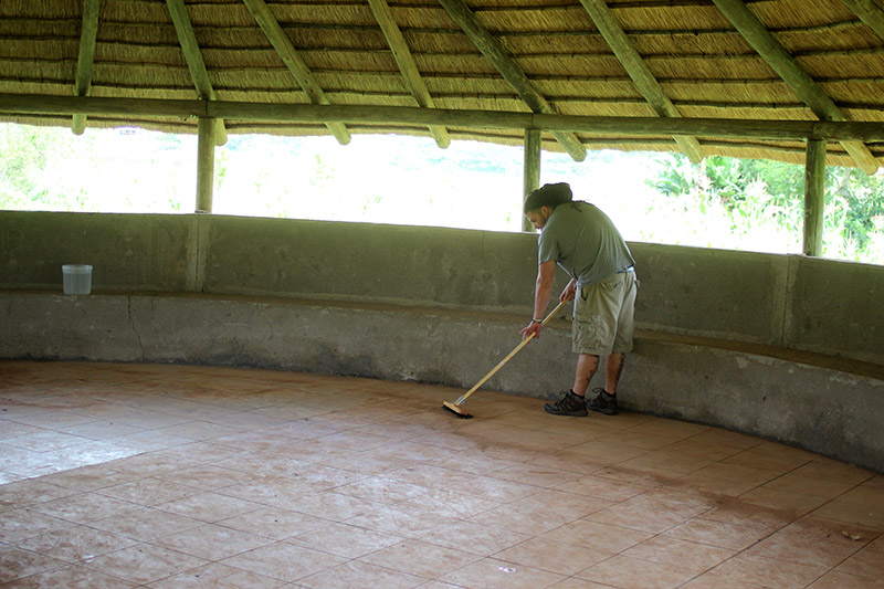 Jordy, along with Zach and Jon tackled the task of cleaning the prayer hut floor. Due to recent heavy rains, it was flooded with mud and water. The hut was unusable and the families did not have their usual place of gathering and prayer. By the end of the day, the floor was shiny and all of the orphans were playing on it.