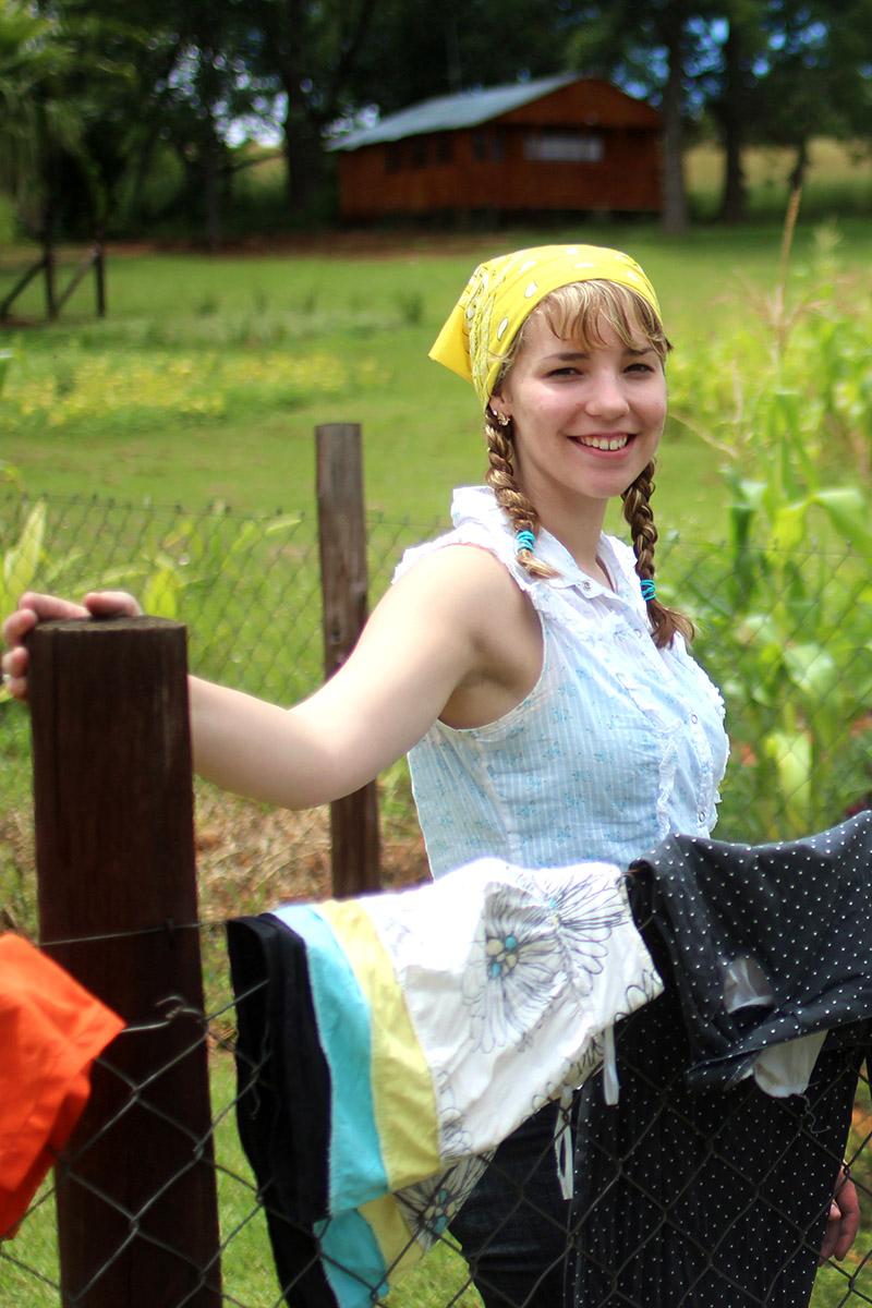 Emily helped wash and dry laundry. The clothes were hung outside and sun dried. The students learned how difficult life might be without the conveniences of home, such as an electric clothes dryer.