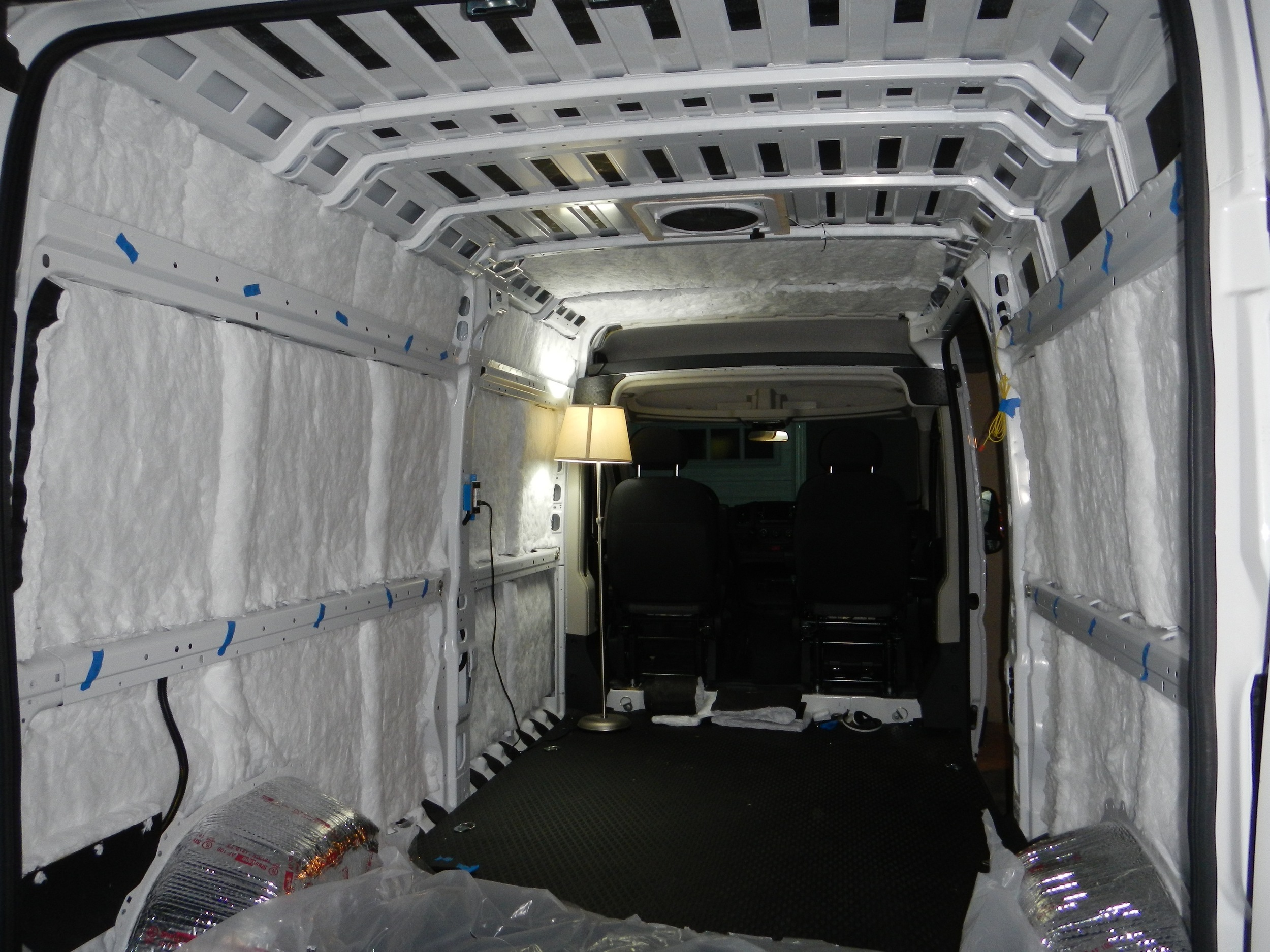 Here we have insulation on most of the walls and some of the ceiling. Somehow we failed to take (or save) a photo of the fully insulated van before moving on to the next step. Doh!