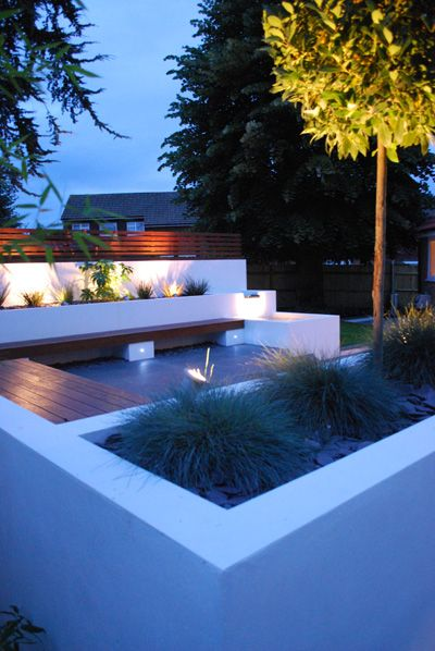 Highlighting of architectural constructed elements such as planters and the plants contained within the white rendered wall - this brings a lovely lightness and colour