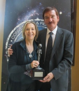 Jennifer Stein and Travis Walton with their EBE award at the 2015 EBE Film Festival (held at the International UFO Congress).   Photo courtesy of   OnWinges Productions.