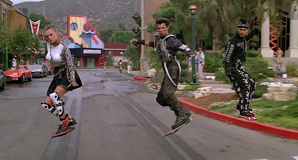 """The """"baddies"""" (a gang consisting of Griff Tannen, Data, Spike, and Whitey) riding on Hover Boards. From the movie  Back To The Future II ."""