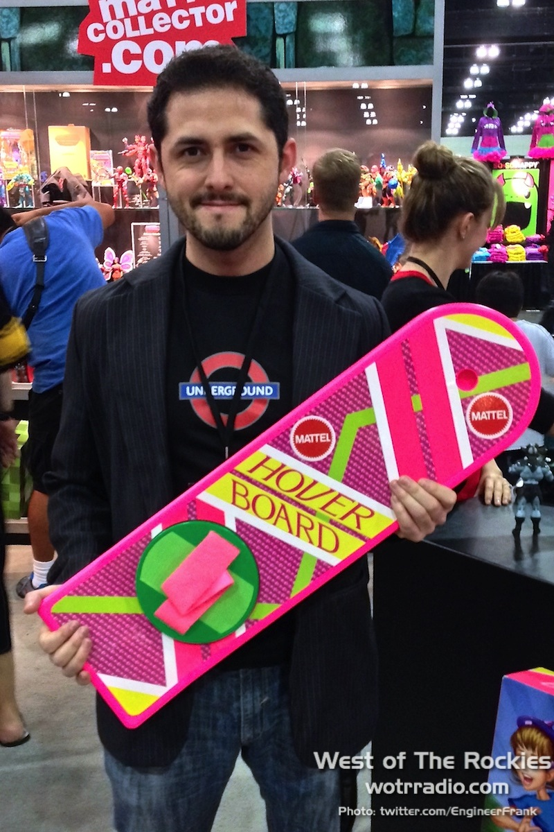 Our very own Engineer Frank, proudly holding a Hover Board. Look at that smile.