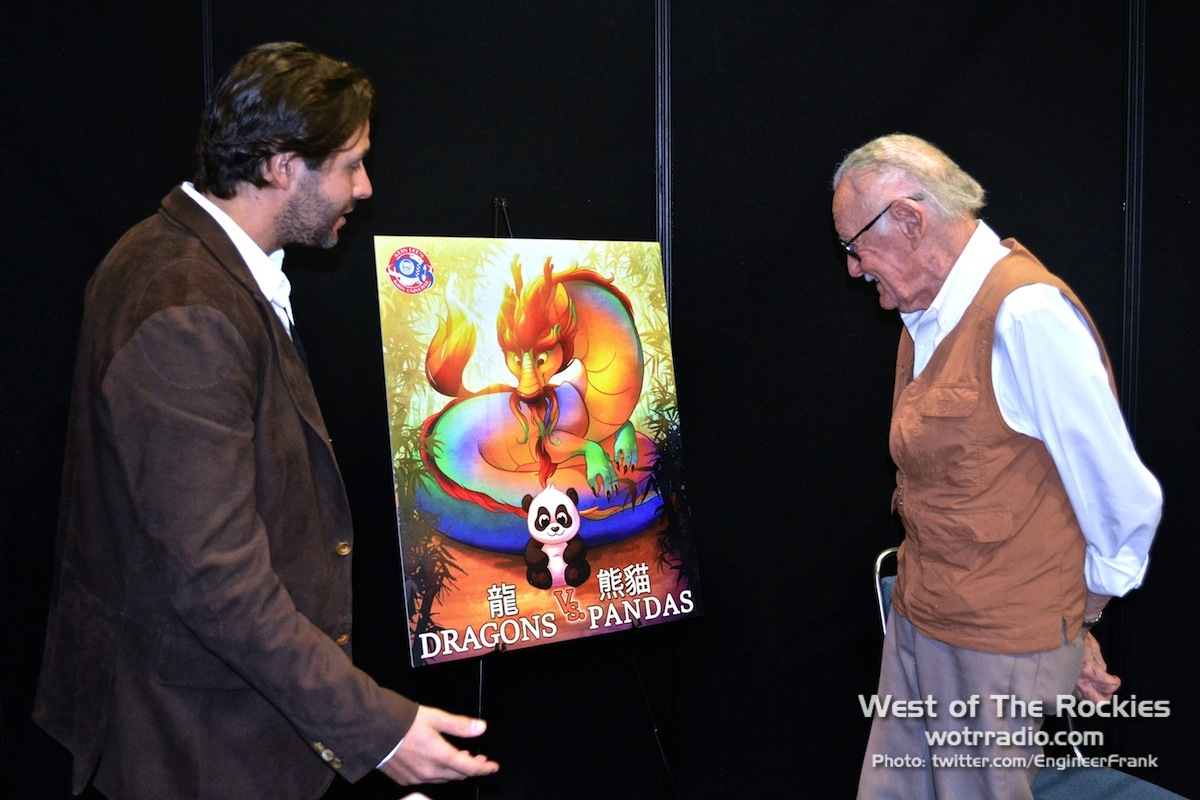 Terry and Stan admiring the  Dragons Vs. Pandas  cover art.