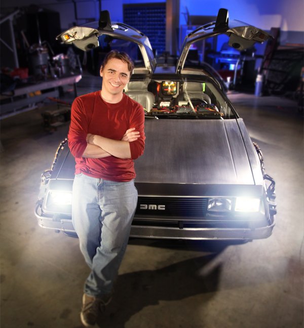 Steve Concotelli, standing proudly by the restored DeLorean.