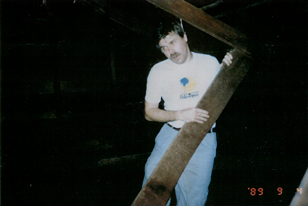 One of the photos taken at the Hernandez house, capturing Jeff Wheatcraft just moments after a cord was wrapped around his neck in the attic and hung from the rafters. Photo by Larry Brooks, courtesy of BarCon Productions.