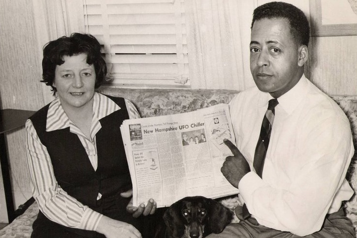 Betty and Barney Hill holding newspaper with the account of their abduction. (c. 1966)