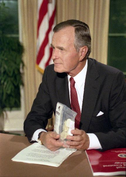 Former CIA Director and U.S. President,  George H. W. Bush  holds up a bag of crack cocaine during his Address to the Nation on National Drug Control Strategy.