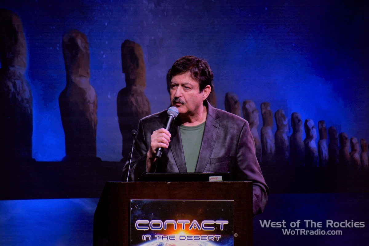 George Noory hosting a panel.  Contact In The Desert 2019.
