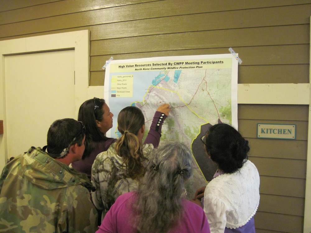 Above: Puu Anahulu residents place stickers on valued areas on a map that would eventually wind-up in the final Northwest Hawaii Island CWPP.